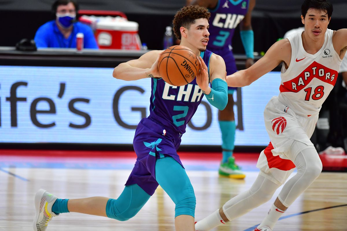 LaMelo Ball of the Charlotte Hornets passes the ball during the first half against the Toronto Raptors at Amalie Arena on January 14, 2021 in Tampa, Florida.