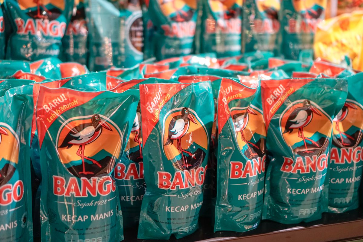 rows of small turquoise bags that say kecap manis