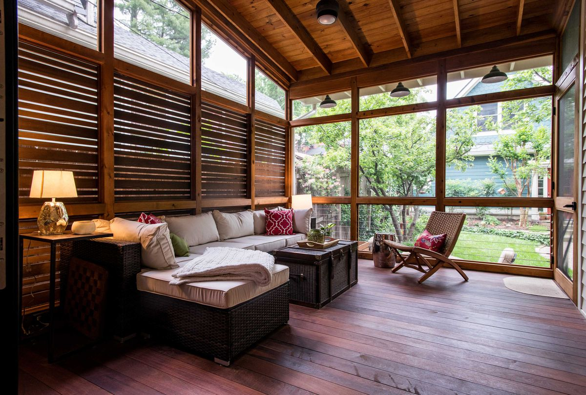 Screened in porch with wood floors and accent walls