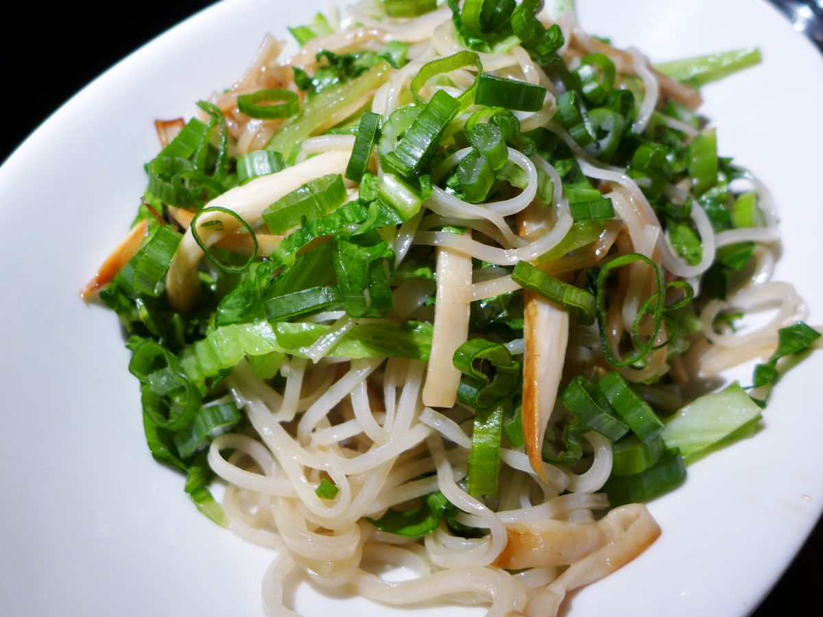 A bowl of pho noodles tossed with a julienne of trumpet mushrooms.