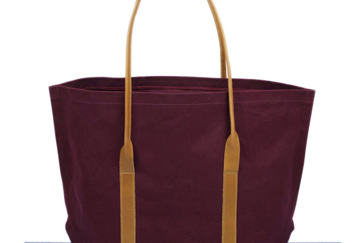 """Canvas Tote in Burgundy, <a href=""""http://shop.mimotstudio.com/product/canvas-utility-tote-burgundy"""">$70</a> at Mimot Studio"""