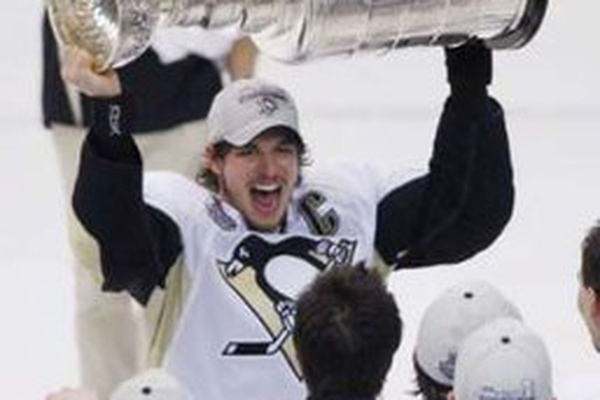 sidney with cup