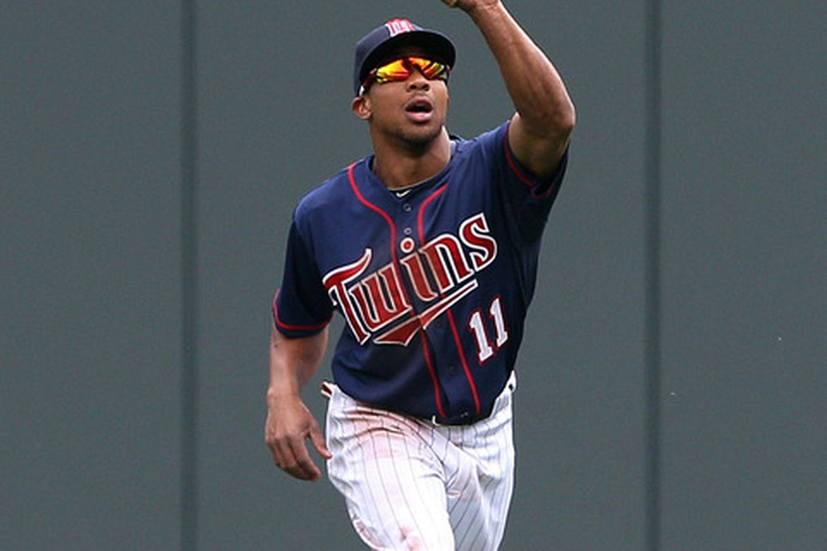 May 30, 2012; Minneapolis, MN, USA: Minnesota Twins right fielder Ben Revere (11) catches a fly ball hit by Oakland Athletics second baseman Jemile Weeks (not pictured) in the fifth inning at Target Field. Mandatory Credit: Jesse Johnson-US PRESSWIRE