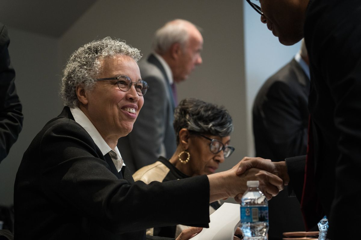 Cook County Board President Toni Preckwinkle, left, and Ald. Carrie Austin, center.