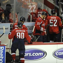 Members of the Washington Capitals including Marcus Johansson (90), of Sweden, Joel Ward (42), Jason Chimera (25) and Mike Green (52) exit the ice after they lost 4-3 in overtime to the Boston Bruins in Game 6 of an NHL hockey Stanley Cup first-round playoff series, Sunday, April 22, 2012, in Washington.