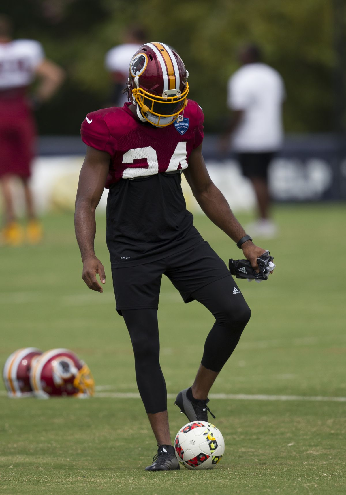 Josh Norman with a soccer ball