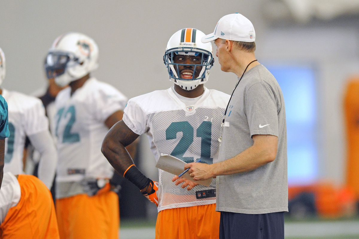 July 27 2012; Davie, FL, USA; Miami Dolphins defensive back Vontae Davis (left) talks with head coach Joe Philbin (right) during practice at the Dolphins training facility. Mandatory Credit: Steve Mitchell-US PRESSWIRE