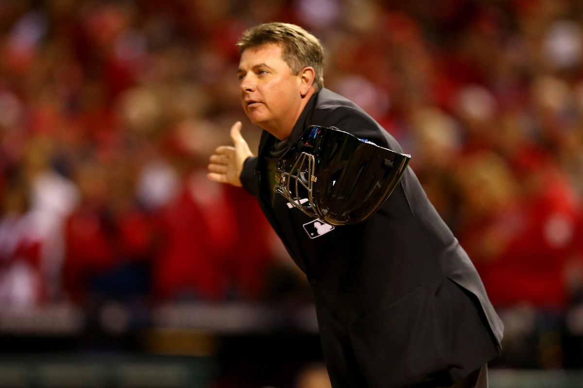 Home plate umpire Greg Gibson wonders where the Dodgers offense went.