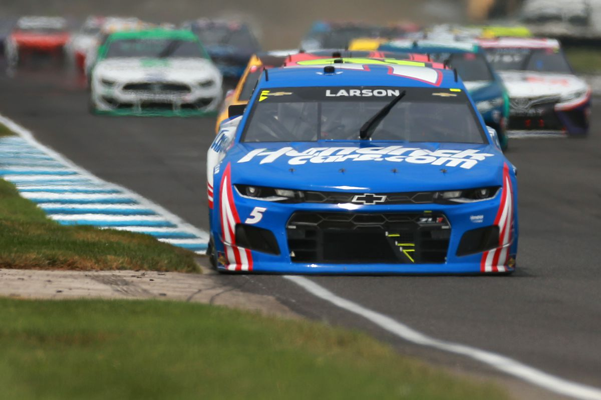 Kyle Larson, driver of the #5 HendrickCars.com Chevrolet, leads the field during the NASCAR Cup Series Verizon 200 at the Brickyard at Indianapolis Motor Speedway on August 15, 2021 in Indianapolis, Indiana.