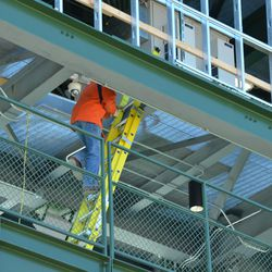 10:34 a.m. Worker climbing into the left-field video board -