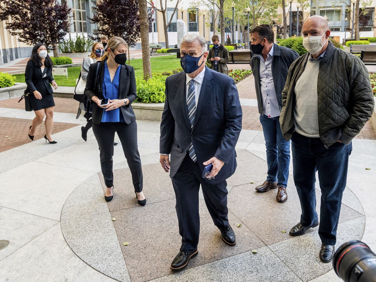 Phil Schiller, an Apple executive, enters the Ronald V. Dellums building in Oakland, Calif., on Monday, May 3, 2021, to attend a federal court case brought by Epic Games