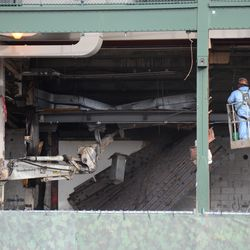 1:27 p.m. Demolition work continues, in the space above the ticket windows -