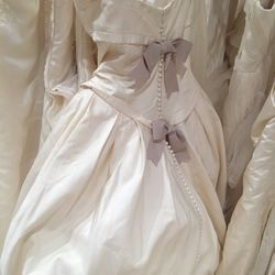 Gown with bows and hook and eye back, $500