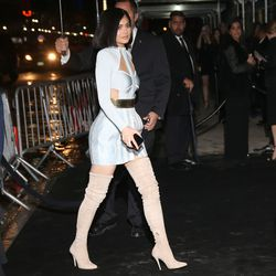 Kylie Jenner ditches the long gown from the red carpet for cutouts and thigh-high boots.