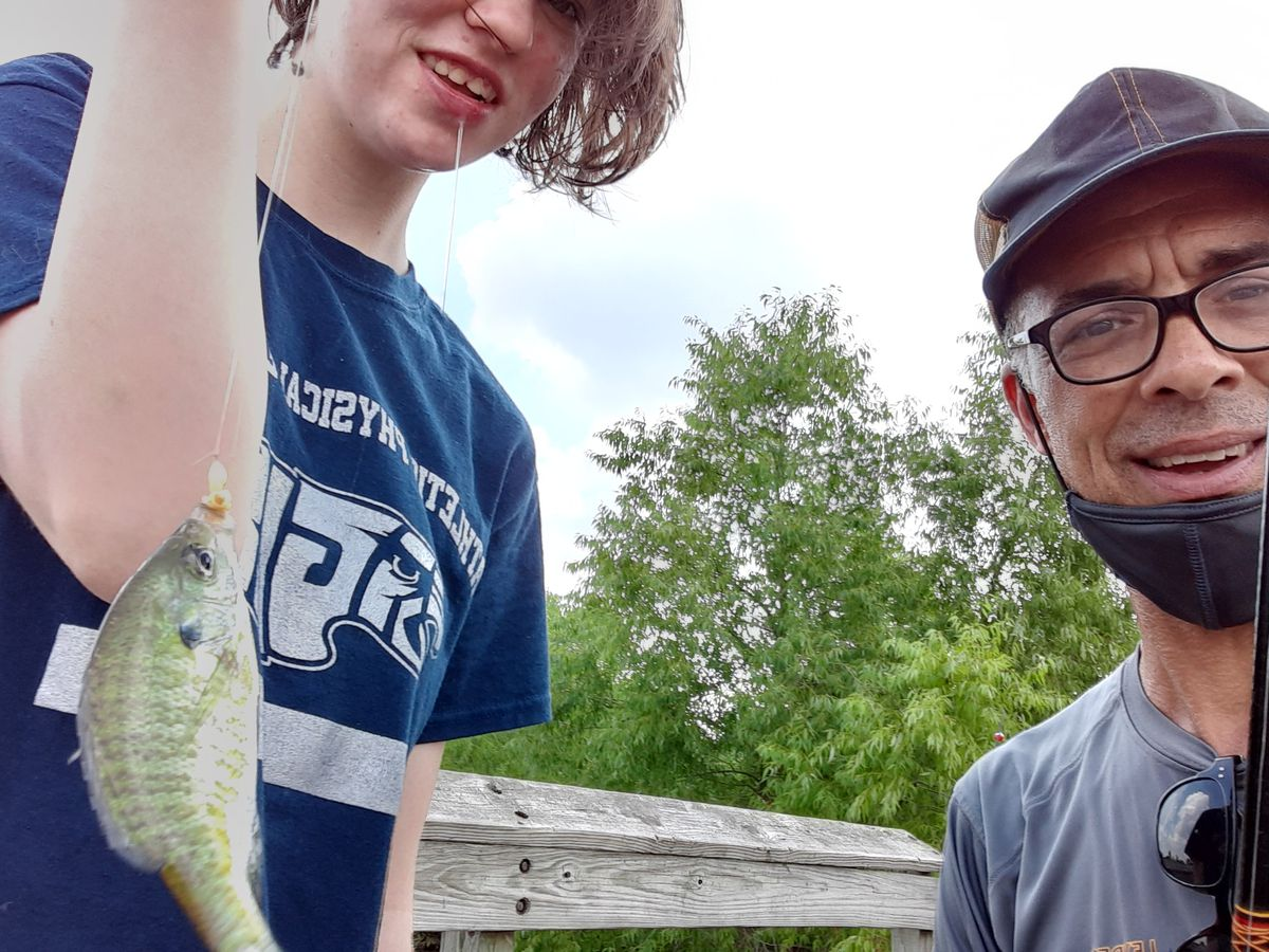 Krissy Barron, one of the people taught fishing by Leyden bass-fishing coach Rob Abouchar, showed her reaction when catching this bluegill while they fished at Wood Dale Grove. Provided photo