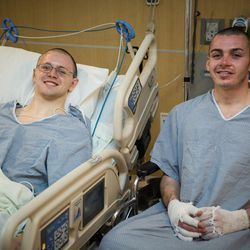 Mason Wells, left, and his former missionary companion, Joseph Empey, are pictured together at the University Hospital in Salt Lake City. Both young men were injured in the Belgium terrorist airport bombing on March 22, 2016, while serving as missionaries.
