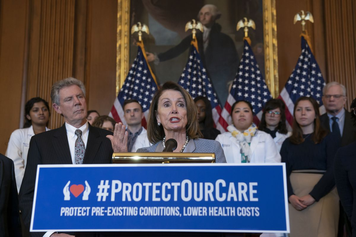 FILE - In this March 26, 2019 file photo, Speaker of the House Nancy Pelosi, D-Calif., joined at left by Energy and Commerce Committee Chair Frank Pallone, D-N.J., speaks at an event to announce legislation to lower health care costs and protect people wi