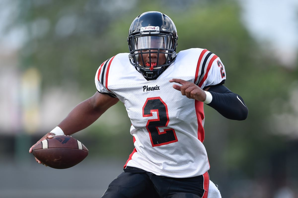 Phoenix's Jamon Gooden (2) runs the ball during the game against Back of the Yards.