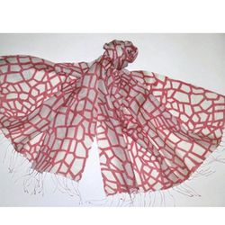 """An oversized scarf will keep you warm on the plane and serve as a sarong, makeshift halter, or a stylish turban. <a href=""""http://www.scarlettalley.com/catalog/ProductDisplay.cfm?id=375874&cid=396"""">Sayami New York Giraffe Print Scarf</a>, $79.95 at Scarlet"""