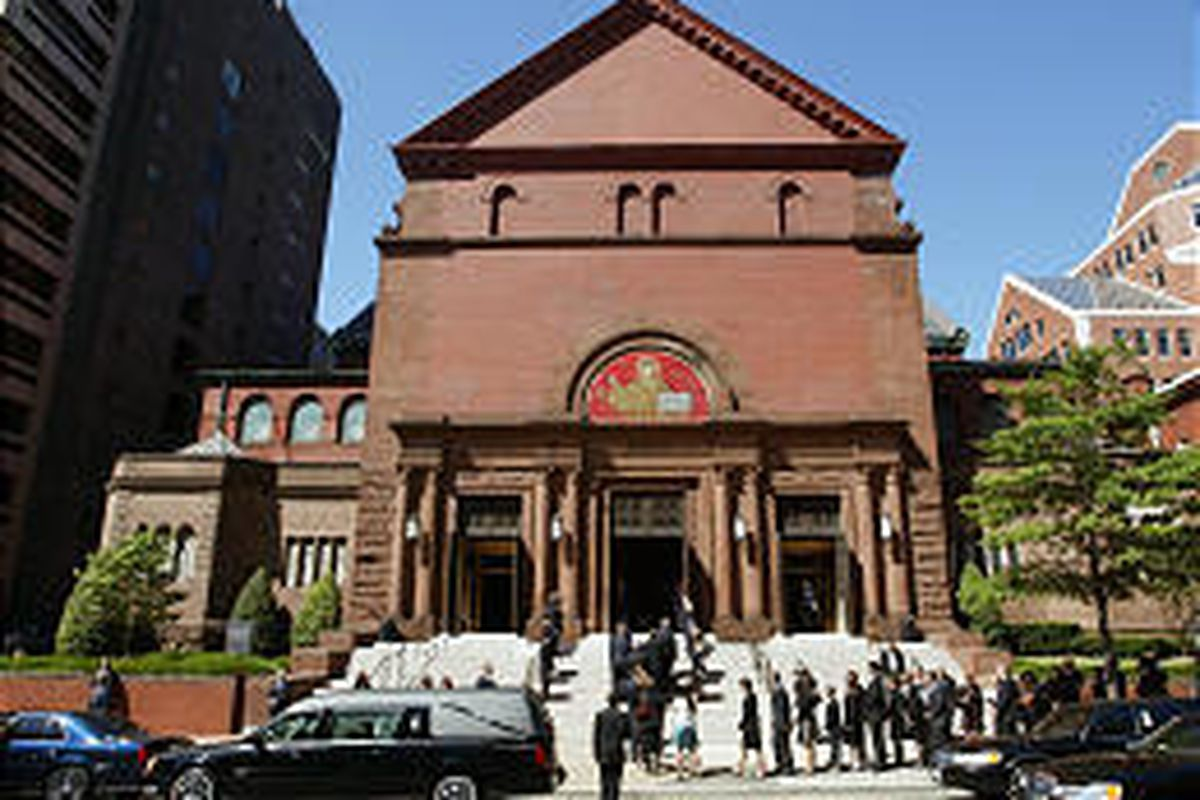 The casket bearing Chief Justice William H. Rehnquist's body is brought to Saint Matthew's Cathedral.