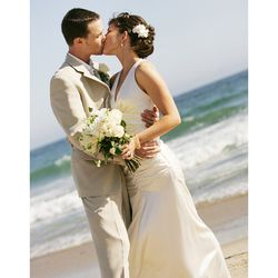 """""""I was married in Malibu on June 21, 2007. I wanted to go for a simple yet elegant feel. I ultimately chose a form-fitting silk dress with a lace back by <b>Jessica McClintock</b>. I was so pleased with the overall feel of the look, and it fit very well w"""