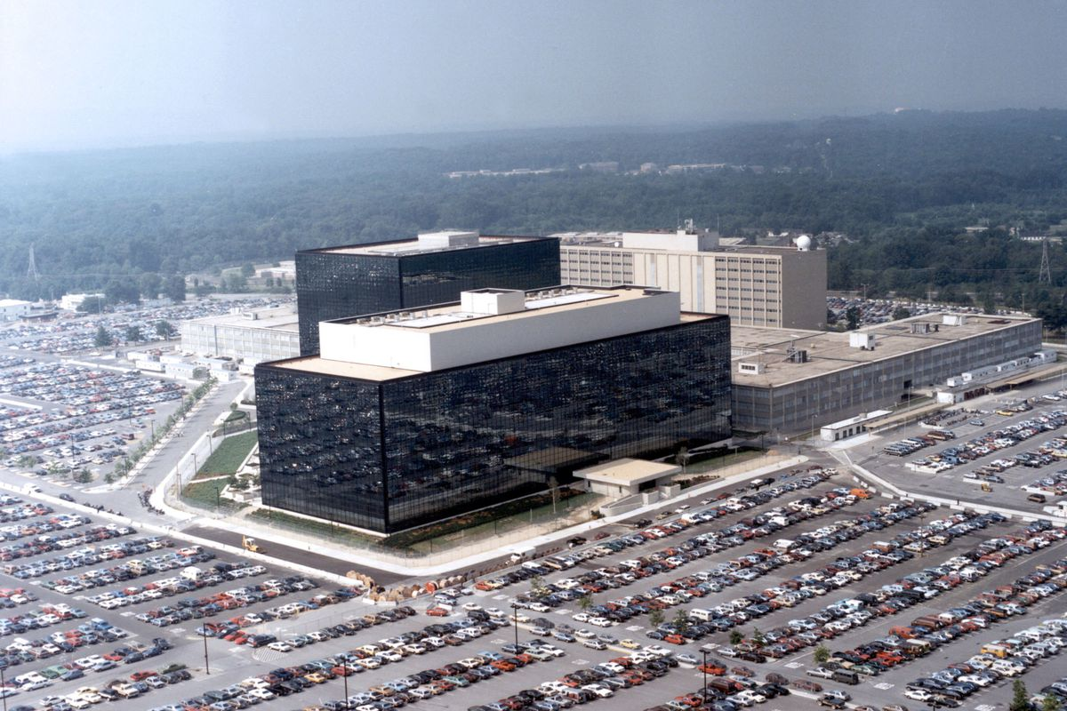 The National Security Agency headquarters building in Fort Meade, Maryland, surrounded by parked cars.