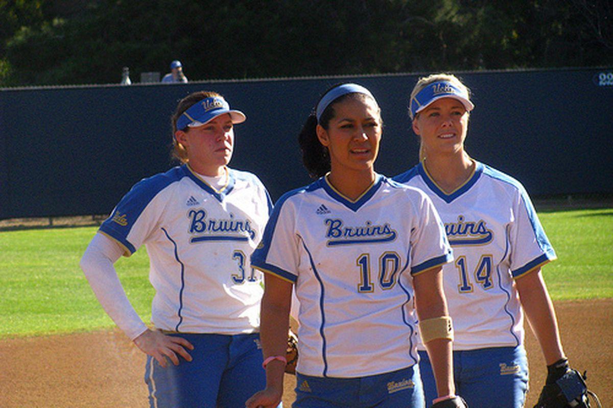 "<em>Megan Langenfeld, Lauren Mirabal, and Julie Burney are just one win away. Photo Credit: <a href=""http://www.flickr.com/photos/uclasoftball/3321412639/"" target=""new"">UCLA Softball (flickr) </a></em>"