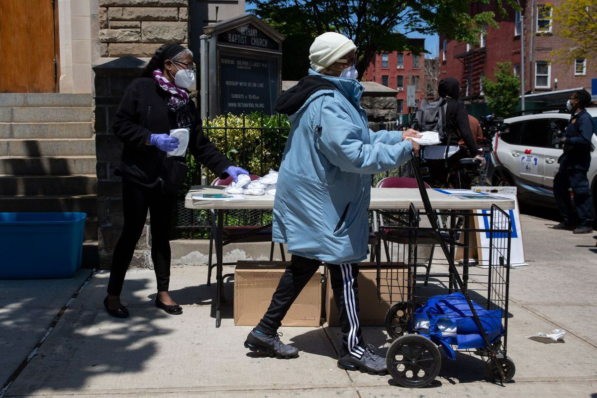 Advocates with Metro IAF hand out free masks to Bed-Stuy, Brooklyn residents, May 13, 2020.