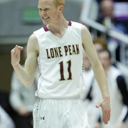 Lone Peak's T.J. Haws celebrates a threw pointer against Alta during the 5A State Championship game in Ogden Saturday, March 2, 2013.