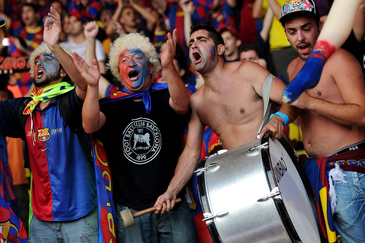 MONACO - AUGUST 26:  FC Barcelona fans cheer prior to the start of the UEFA Super Cup match between FC Barcelona and FC Porto at Louis II Stadium on August 26, 2011 in Monaco, Monaco.  (Photo by Jasper Juinen/Getty Images)