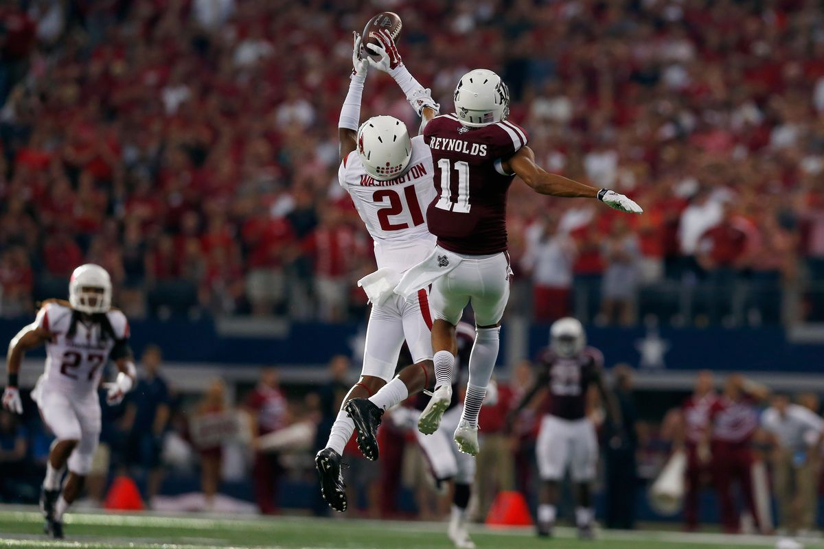 Carroll Washington's 4th quarter interception was one of many times Arkansas stopped the mighty A&M offense.
