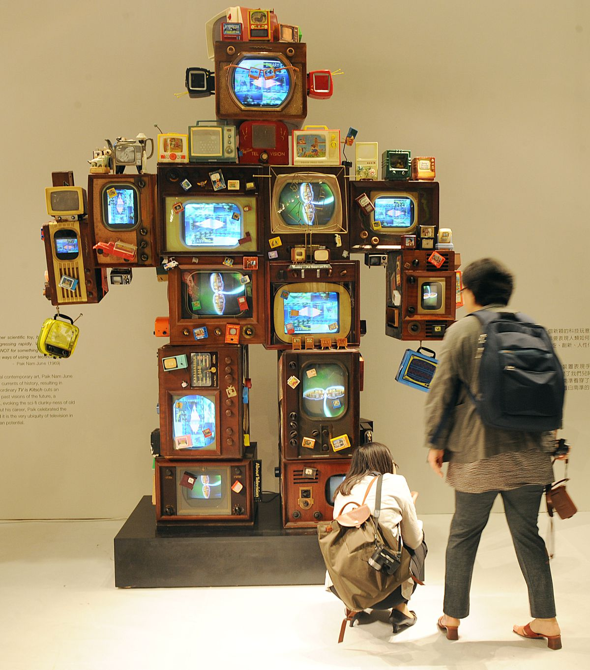 Inside The Desperate Fight To Keep Old Tvs Alive Verge Mechanical Tv Monitor Part 2 Led Driver Schematic Visitors Look At Artwork By Nam Jun Paik June Paiks