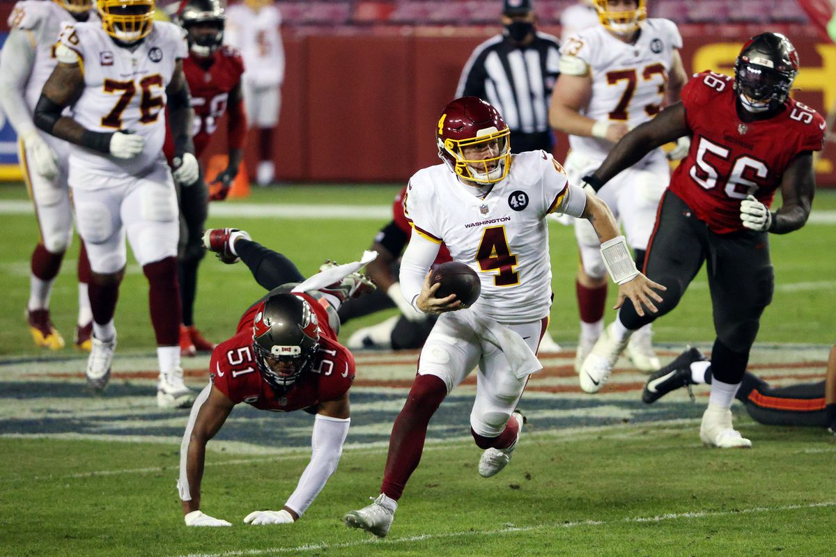 Quarterback Taylor Heinicke #4 of the Washington Football Team scrambles during the 3rd quarter of the game against the Tampa Bay Buccaneers at FedExField on January 09, 2021 in Landover, Maryland.