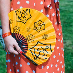 Veuve accessories could be found everywhere, from umbrellas to picnic blankets to (much-needed) fans.