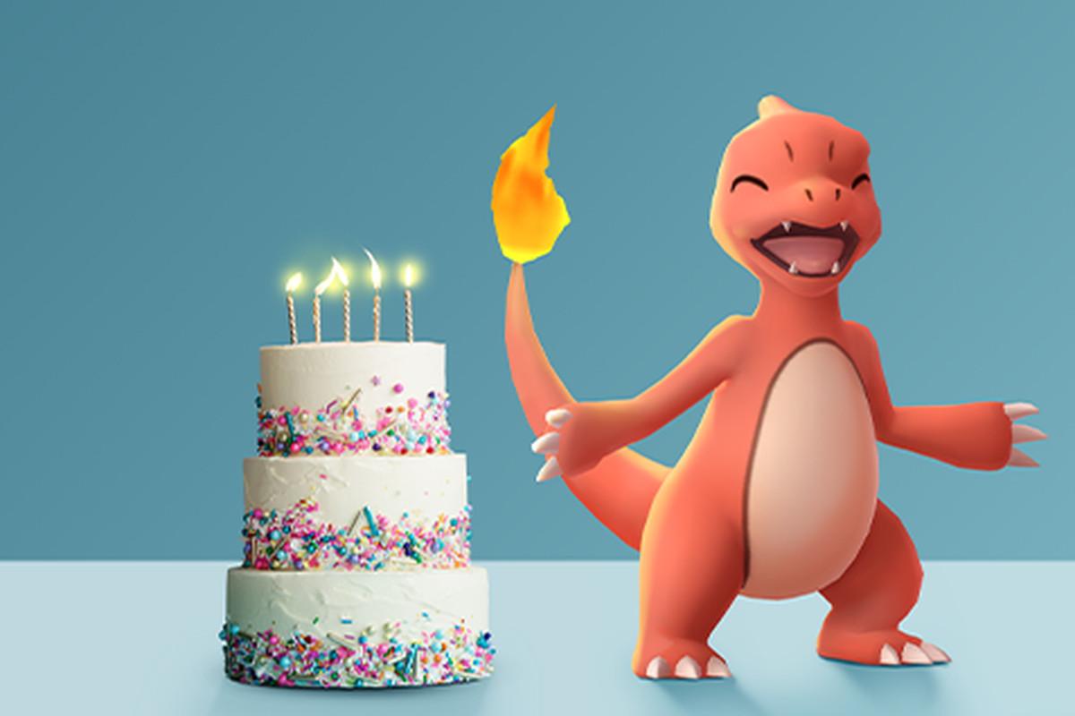 Charmeleon celebrates in front of a birthday cake