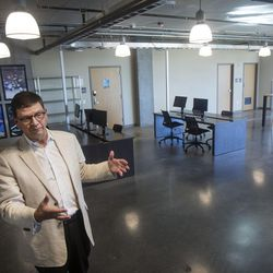 """Troy D'Ambrosio, Lassonde Institute executive director, describes what it's like for students to live on the gaming and programing floor at the Lassonde Studios on the University of Utah campus in Salt Lake City on Friday, June 23, 2017. The entrepreneurial center is most often recognized for its attempt to blur the lines between where students live and where they work. """"It's about getting people to stay with the problem longer,"""" says Thad Kelling, Lassonde Entrepreneur Institute marketing and rublic relations manager."""