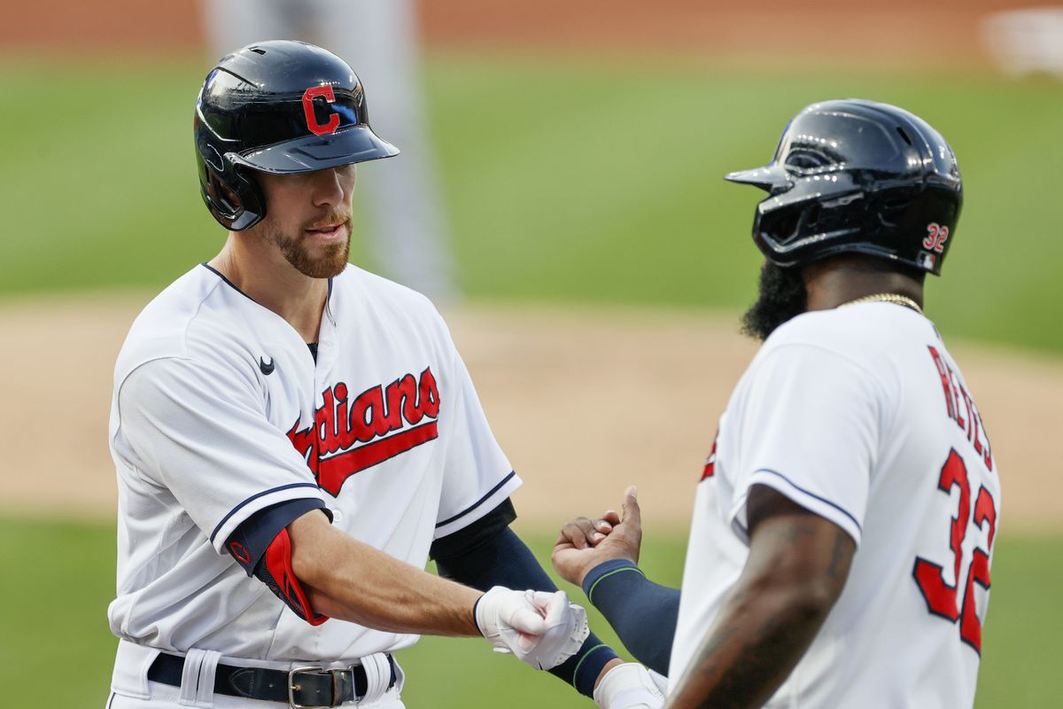 Bradley Zimmer #4 of the Cleveland Indians celebrates with Franmil Reyes after hitting a two run home run off Jordan Lyles #24 of the Texas Rangers during the first inning at Progressive Field on August 26, 2021 in Cleveland, Ohio.