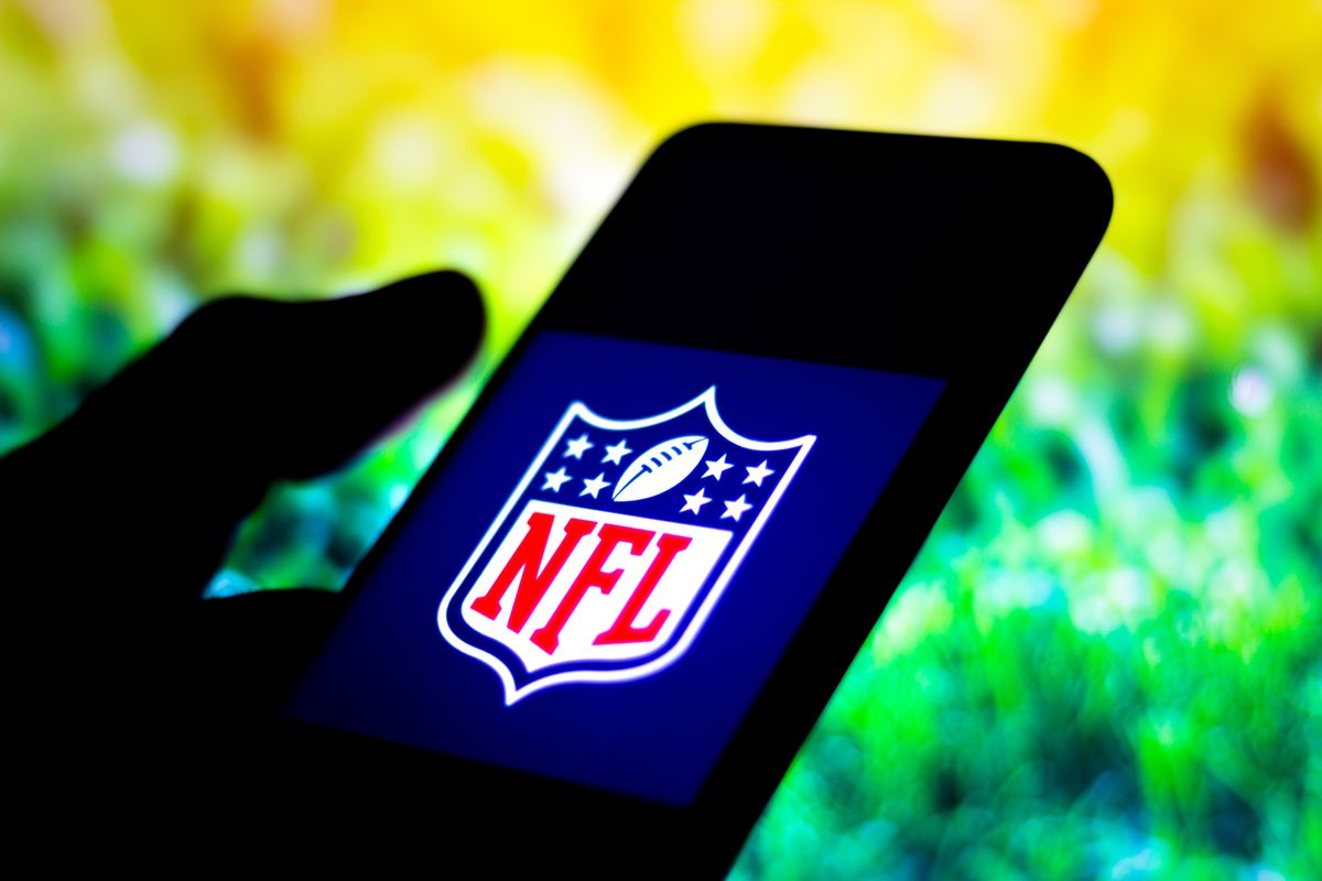 In this photo illustration the NFL (National Football League...