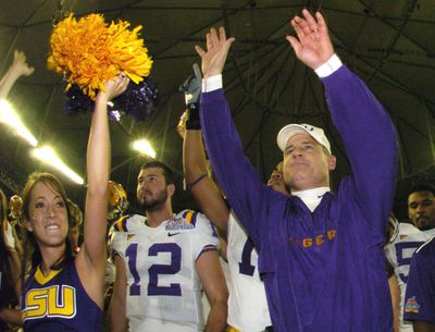 LSU coach Les Miles leads fans in a cheer after defeating the University of Miami in the 2005 Chick-fil-A Peach Bowl at the Georgia Dome in Atlanta, Georgia on December 30, 2005. LSU defeated Miami 40-3.