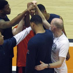 ADVANCE FOR WEEKEND EDITIONS,  APRIL 7-8  - In this photo taken April 5, 2012, new Illinois basketball coach John Groce, right, huddles with some members of his new team and new assistant coach Jamall Walker, left, before practice in Champaign, Ill. Groce was hired last month from Ohio University to replace Bruce Weber.
