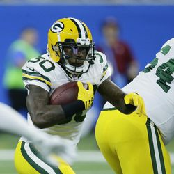 Green Bay Packers running back Jamaal Williams rushes during game against the Detroit Lions, Sunday, Dec. 31, 2017, in Detroit.