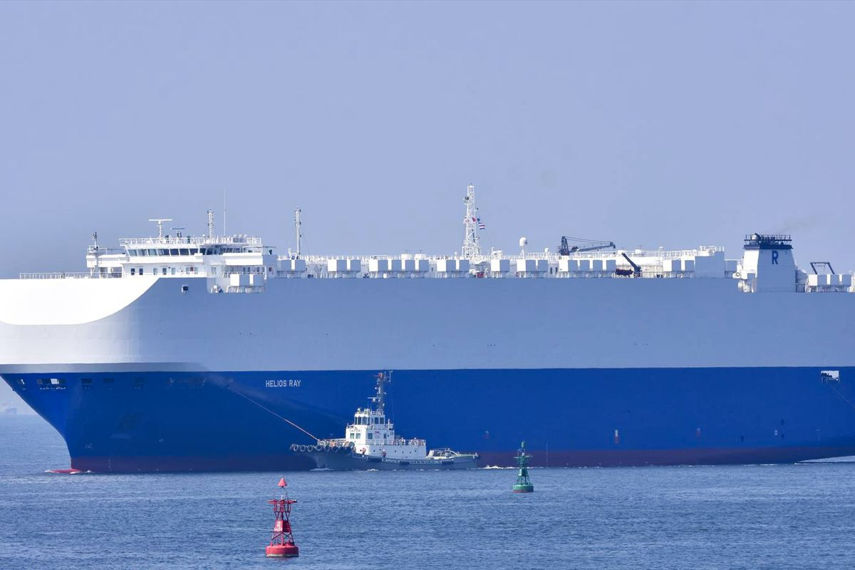 In this Aug. 14, 2020, photo, the vehicle cargo ship Helios Ray is seen at the Port of Chiba in Chiba, Japan