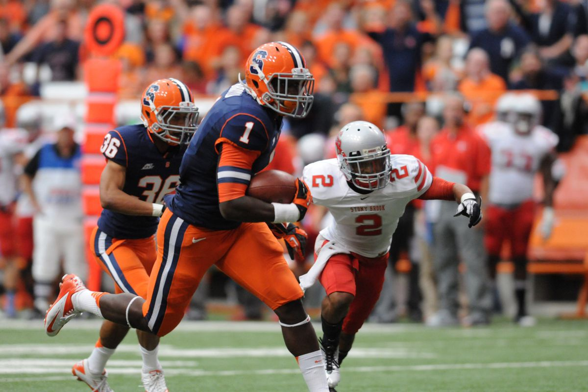 Syracuse Orange running back Ashton Broyld scores a touchdown with Stony Brook Seawolves defensive back Davonte Anderson in pursuit.