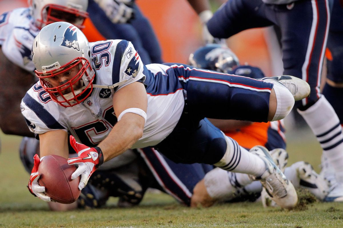 Outside linebacker Rob Ninkovich #50 of the New England Patriots recovers the ball against the Denver Broncos at Sports Authority Field at Mile High on December 18, 2011 in Denver, Colorado.