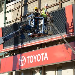 3:13 p.m. The third segment of the marquee being separated from the ballpark -