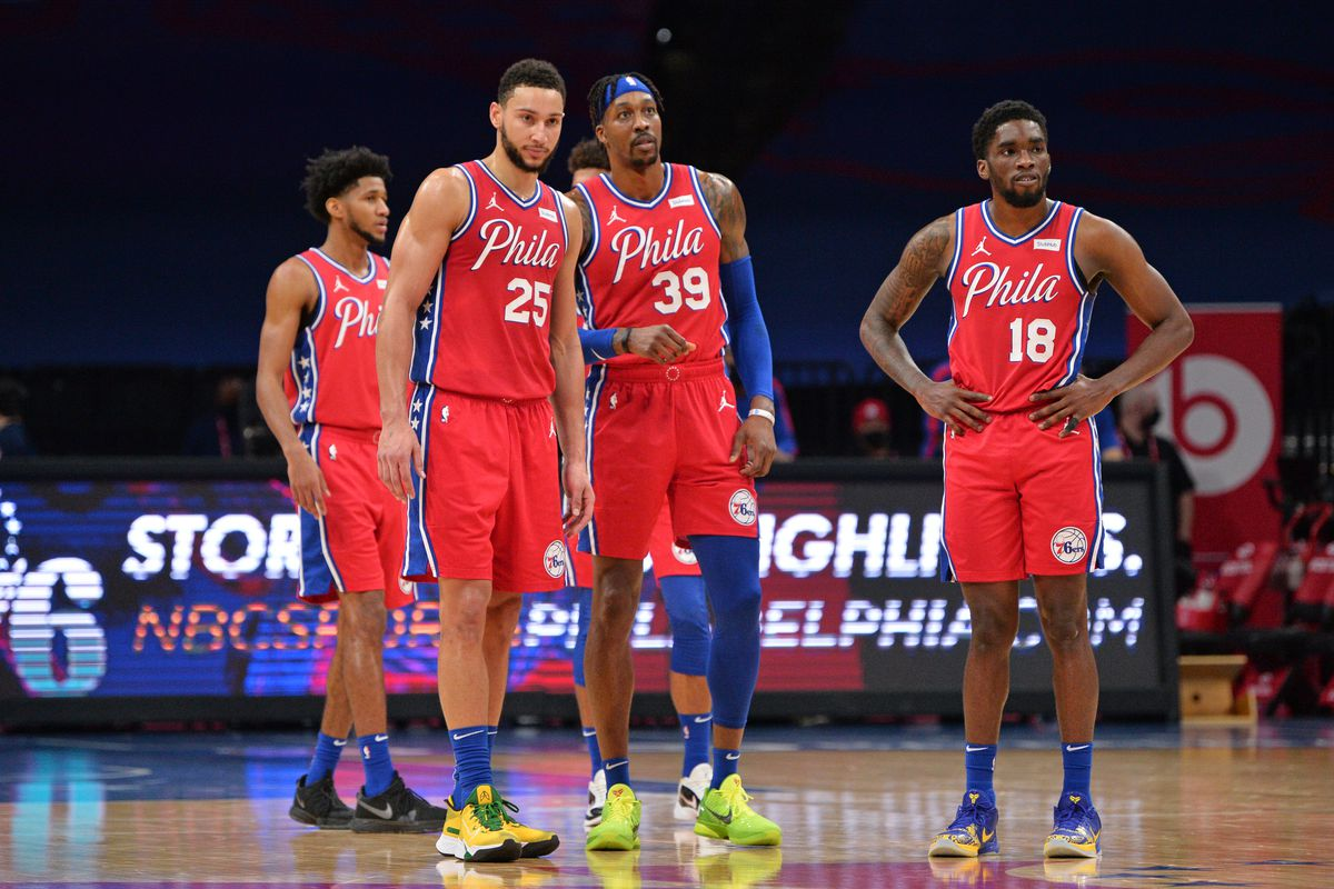 Ben Simmons of the Philadelphia 76ers, Dwight Howard of the Philadelphia 76ers and Shake Milton of the Philadelphia 76ers look on during a game against the Miami Heat on January 14, 2021 at Wells Fargo Center in Philadelphia, Pennsylvania.