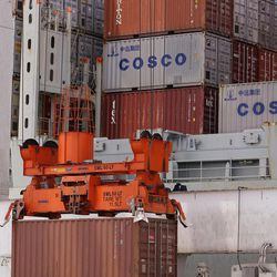 In this  Friday, July 13, 2012, photo, a container ship is loaded at Massport's Conley Terminal in the port of Boston..