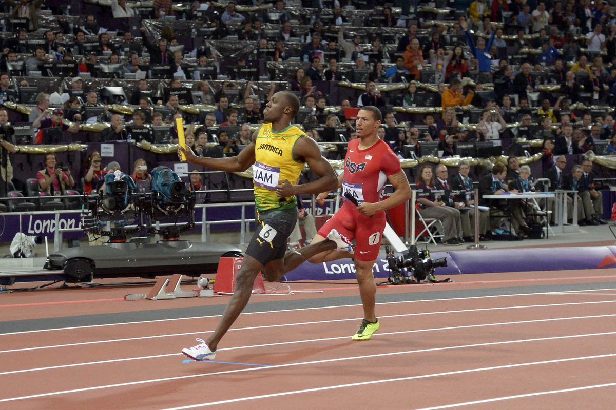 Aug 11, 2012; London, United Kingdom; Usain Bolt  reacts after running the anchor leg on the Jamaica 4 x 100m relay that set a world record of 36.84 in the London 2012 Olympic Games at Olympic Stadium.Mandatory Credit: Kirby Lee-USA TODAY Sports