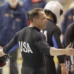 Cory Butner removes his helmet after crossing the finish line after racing in the United States four-man bobsled team trials on Saturday, Oct. 26, 2013, in Park City, Utah. Butner and his crew came in third place. (AP Photo/Rick Bowmer)
