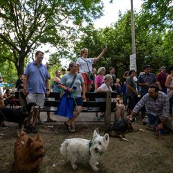 Dozens of dog lovers and their pooches had an inaugural romp at the new dog park. I Maria de la Guardia/Sun-Times